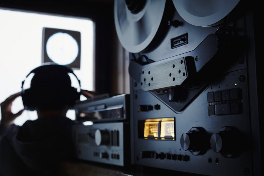 10 May 2013, Germany --- Germany, Bavaria, Man with head phone in recording studio --- Image by © Daniel Schweinert/Westend61/Corbis